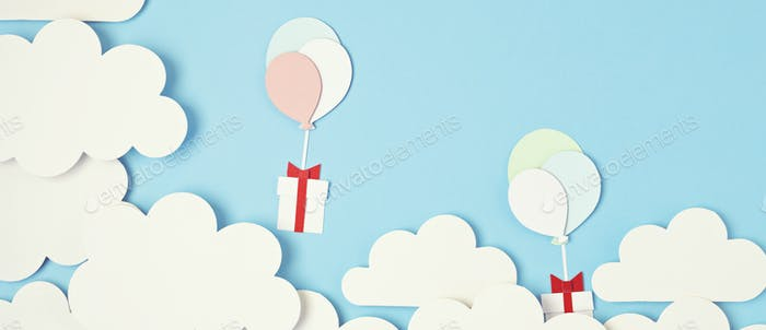 Papercut balloons and Gift Box floating in blue sky with clouds. Happy Bithday, Merry Christmas