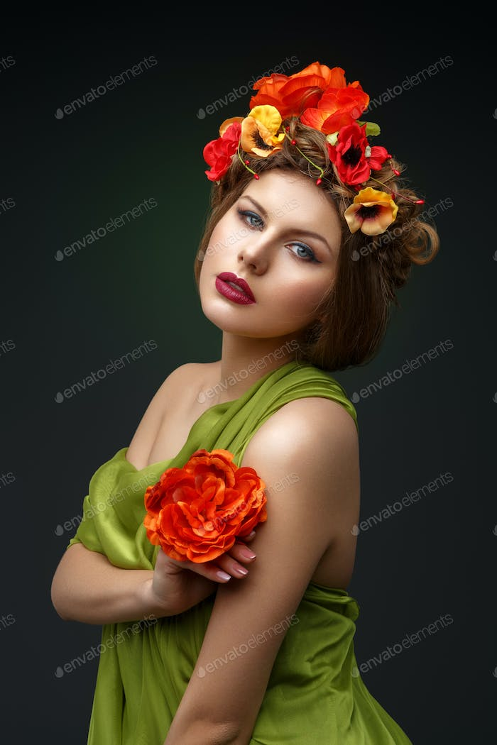 girl in long dress with flowers on head