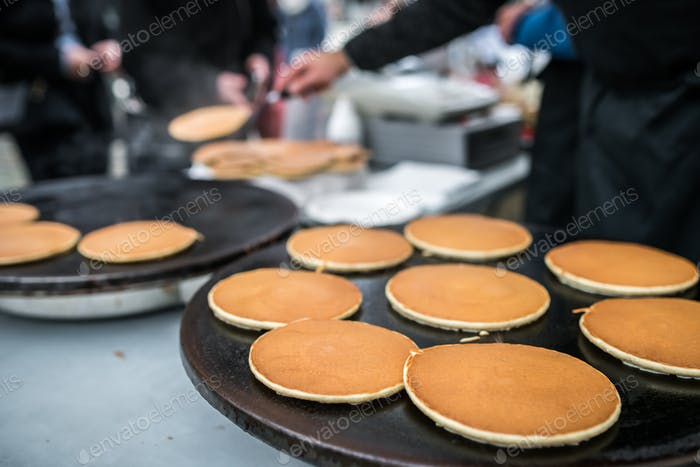 Delicious pancakes on sale on the street food market