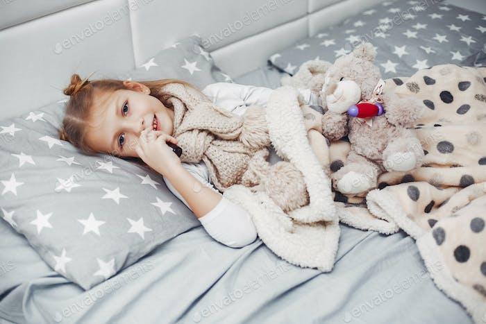 Little illnes daughter in a bedroom