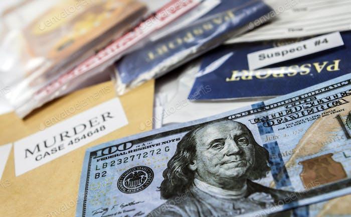 dollar bills and passports in criminal investigation unit, conceptual image