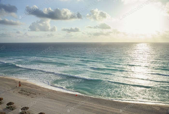 High angle view of sunrise over the ocean and beach in Cancun