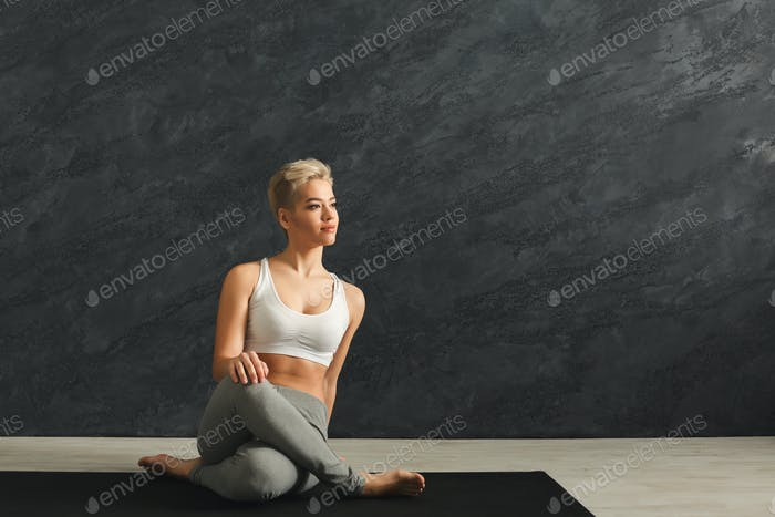 Woman having rest after training yoga in gym