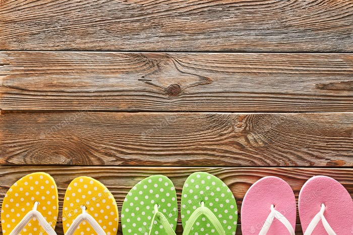 Flip-flops over wooden background