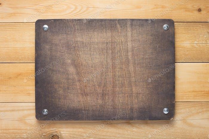 wooden sign board at wall