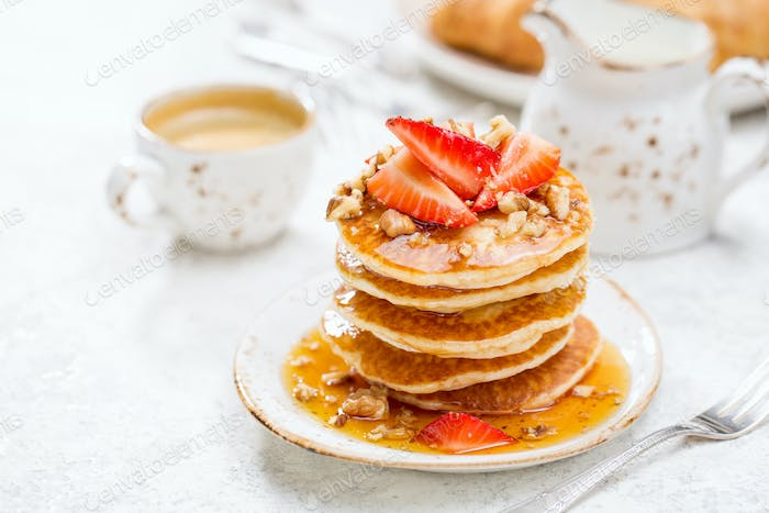 Tasty pancakes with strawberries