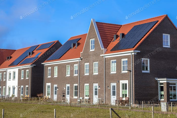 Modern row houses with  solar panels on sunny day