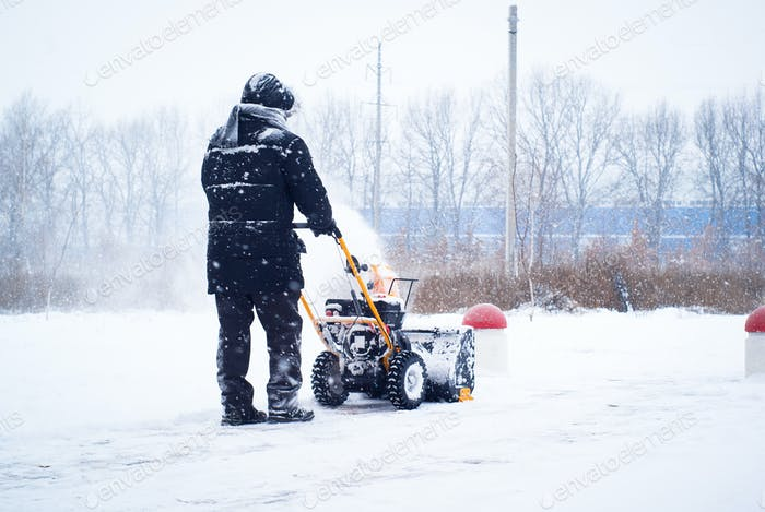 A man cleans snow