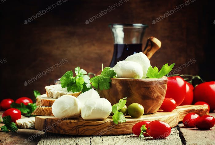 Mozzarella cheese, bread, olives and tomatoes, snack plate