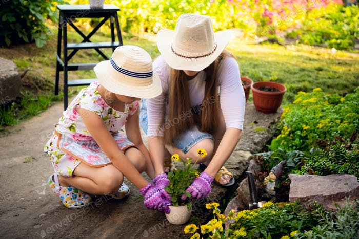 Mother and daughter working in the garden together
