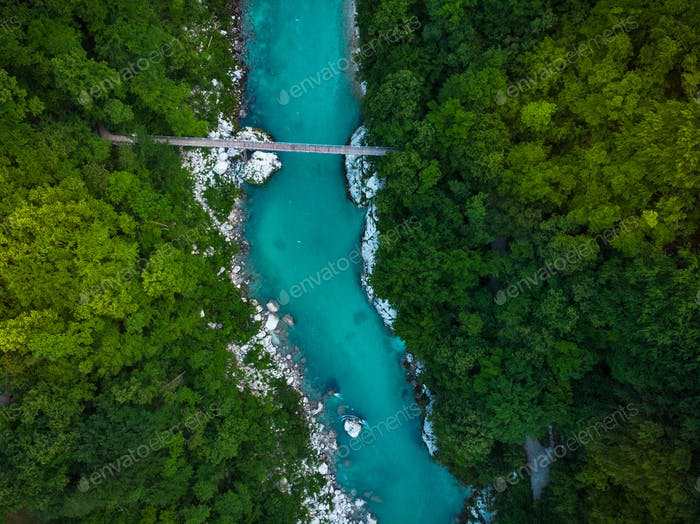 Wooden bridge over Soca river in Slovenia, top down drone image