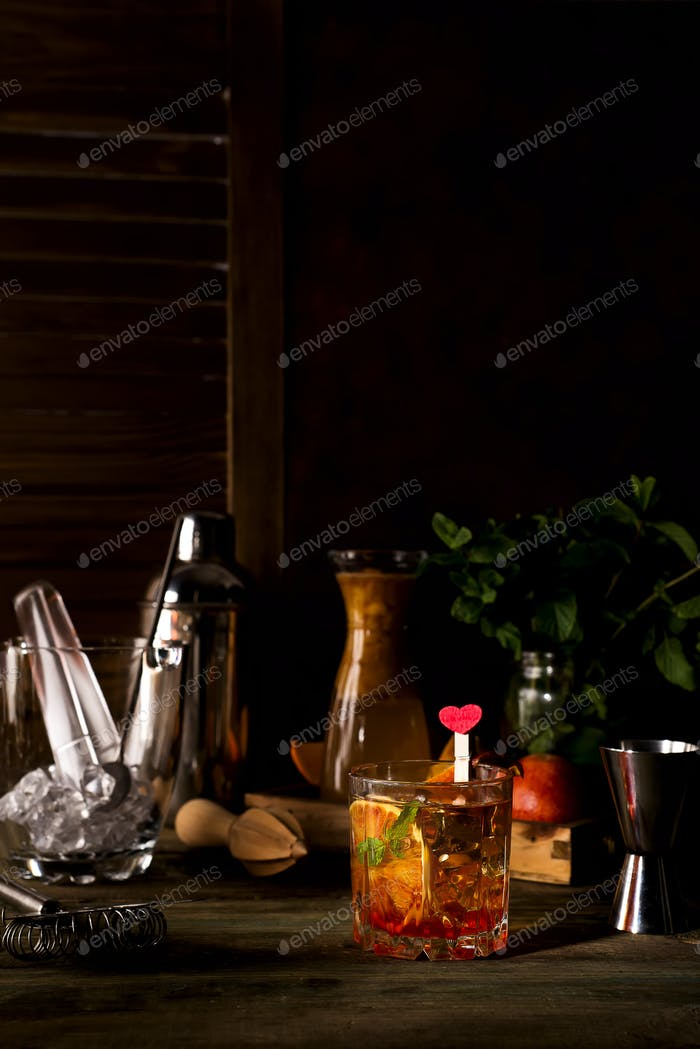 Margarita coctail with ice and mint on wooden background
