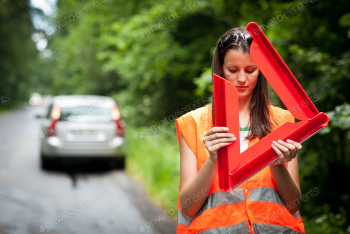 Thumbnail for Young female driver wearing a high visibility vest/safety vest,