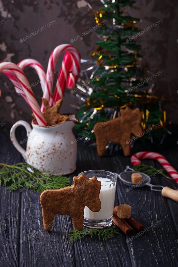 Christmas cookies in shape of deer and milk