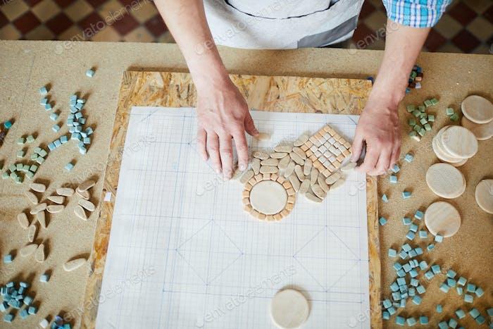 Artist Creating Mosaic in Studio