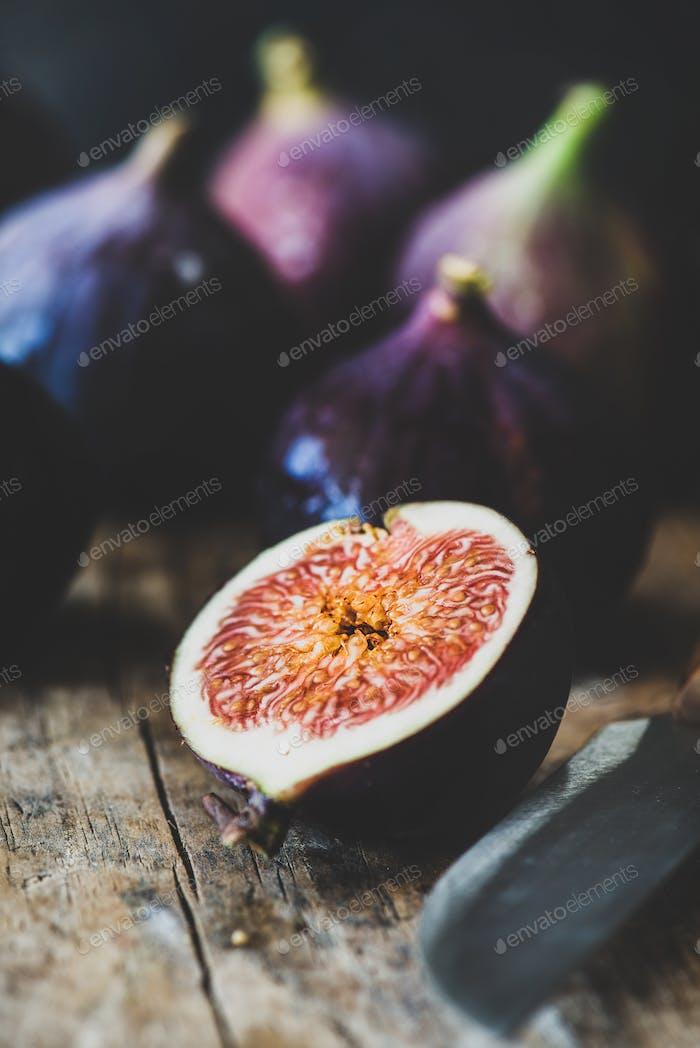 Fresh ripe seasonal purple figs over wooden board