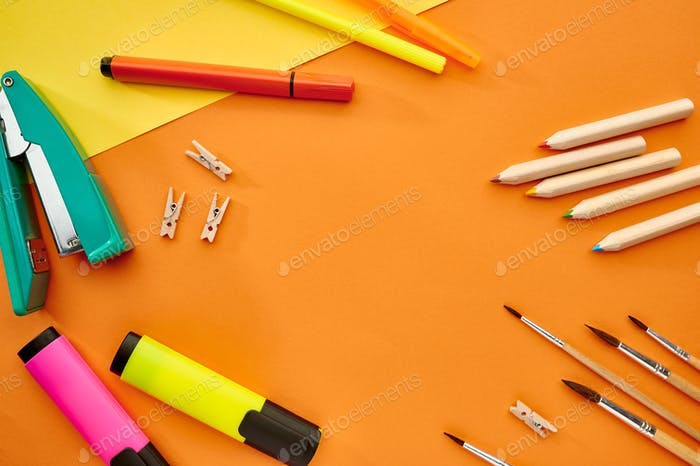 Brushes, markers and stapler closeup, stationery