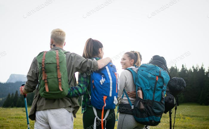 Friends hiking together outdoors exploring the wilderness