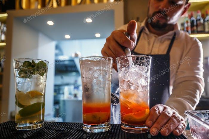 Bartender pours sparkling water