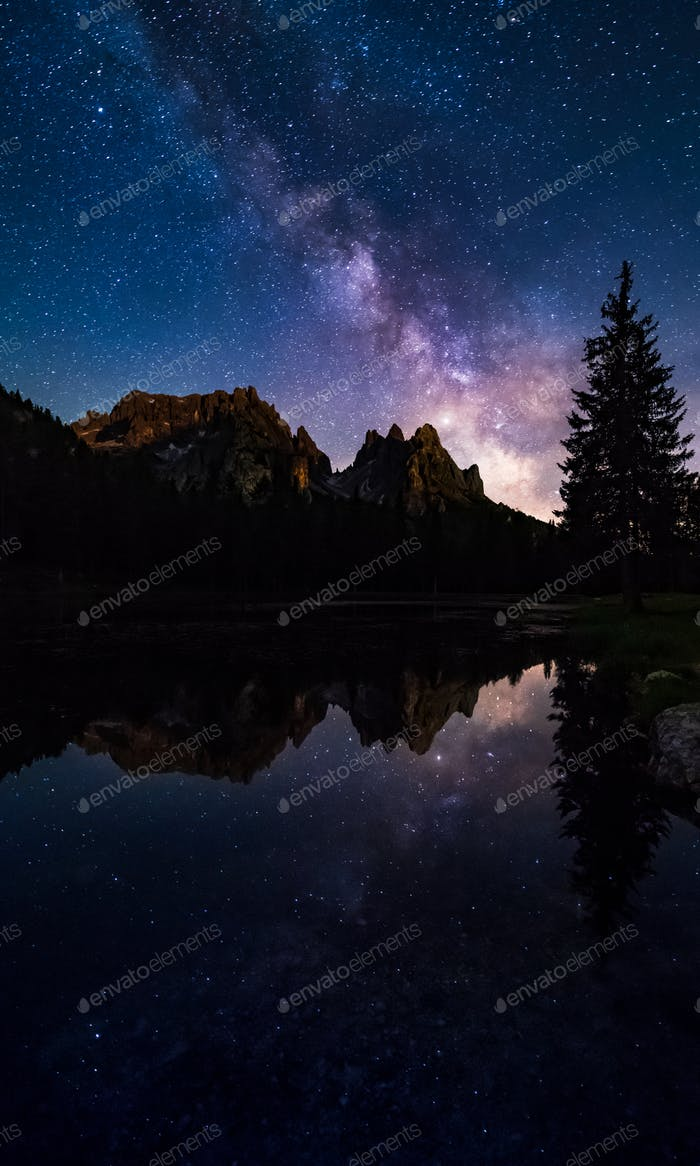 Mliky way reflection over lake Antorno, Dolomites, Italy
