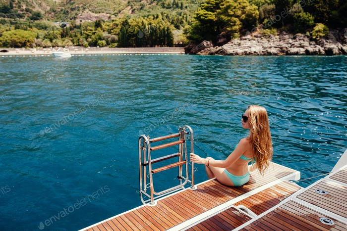 sexy woman relax on yacht in sea on summer vacations