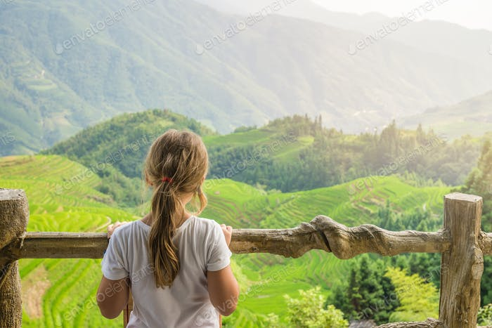 Cute young girl admiring Longji Rice Terraces