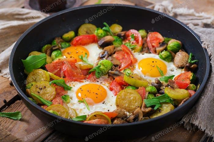 Breakfast for two. Fried eggs with vegetables - shakshuka