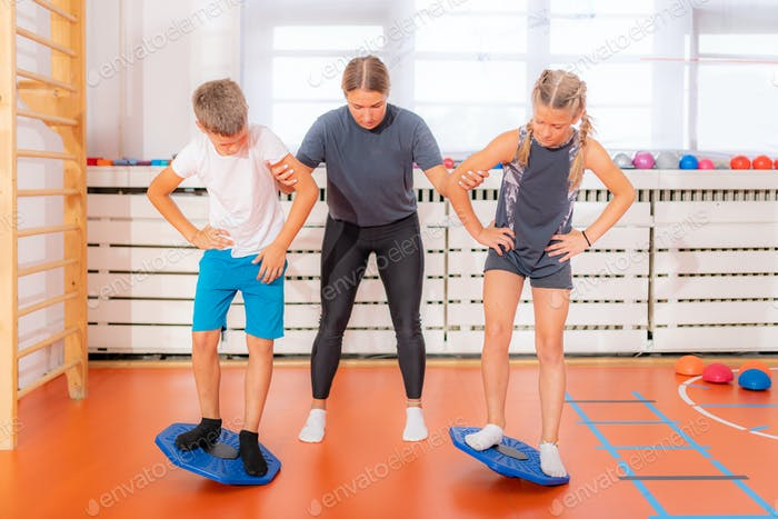 Balance exercises for children, using balancing disks