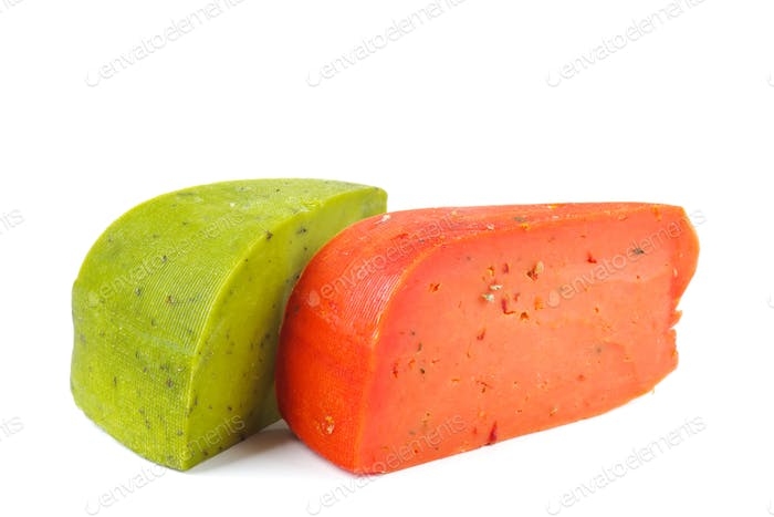 Chunks of red and green cheese isolated on white background