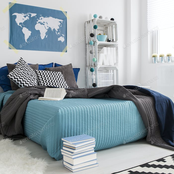 Bedroom with world map on the wall