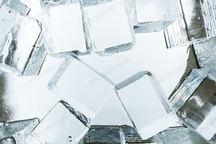 Top View of Transparent Clear Square Ice Cubes on Mirror
