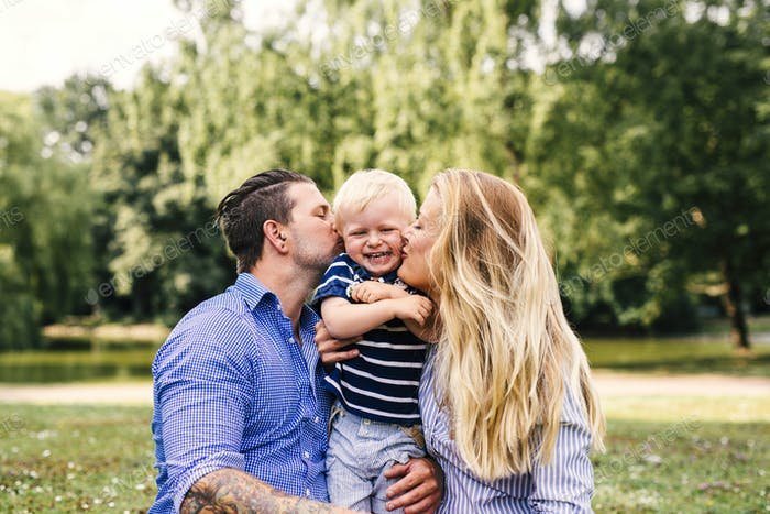 Parents kissing happy son