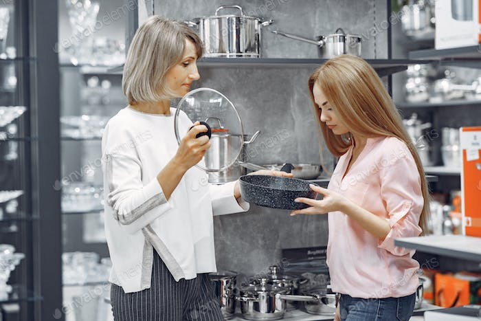 Woman buys dishes in the store