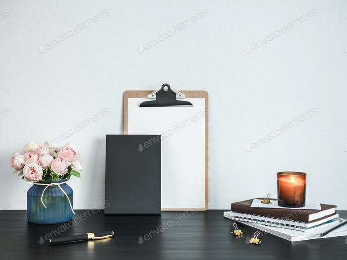 Clipboard with white empty page on table