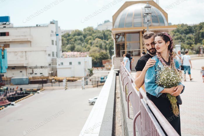 Guy and girl on pier