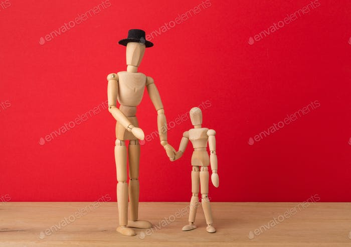 Wooden man mannequin with wooden child