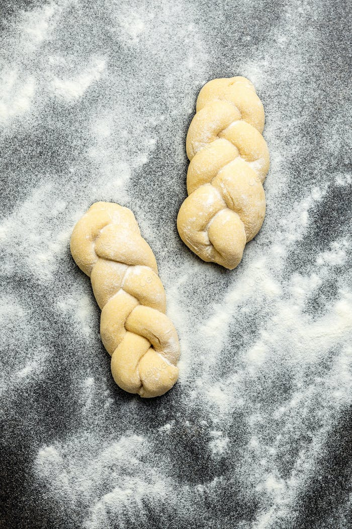 Unbaked braided bun dough. Raw dough.