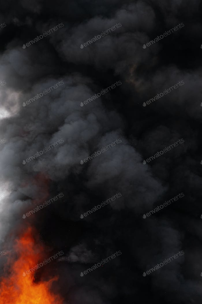 Black Motion Blur Clouds of Strong Red Fire Smoke Covered Sky