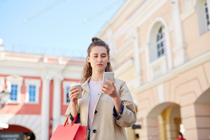 Young woman checking sms