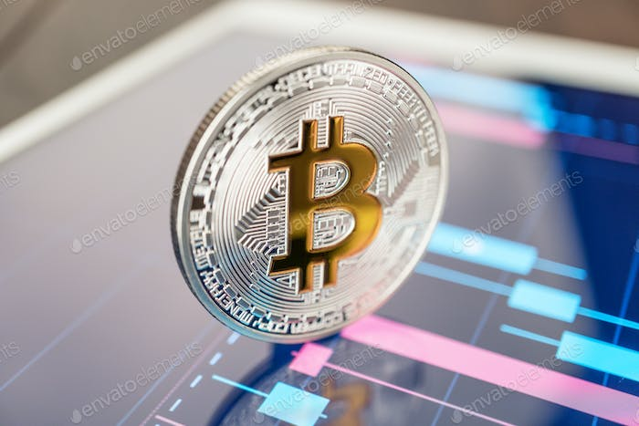 Bitcoin Cryptocurrency On The Tablet