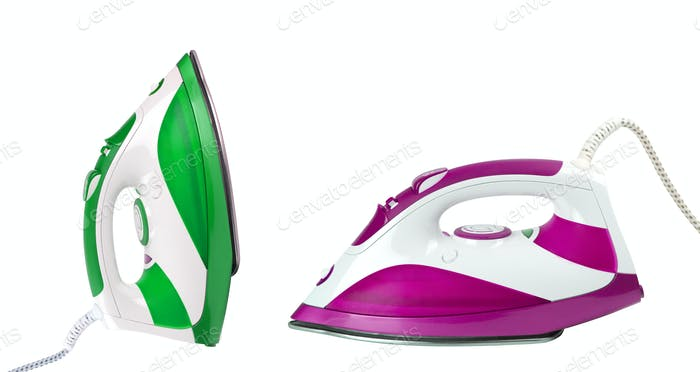 two steam irons isolated on white background
