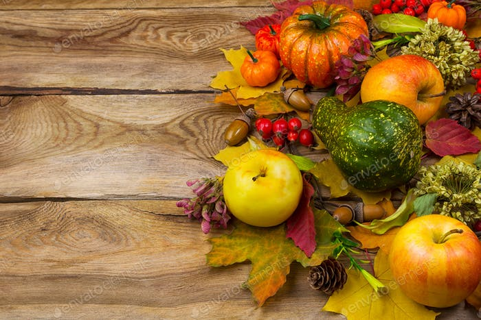 Background with fall leaves and apples, copy space