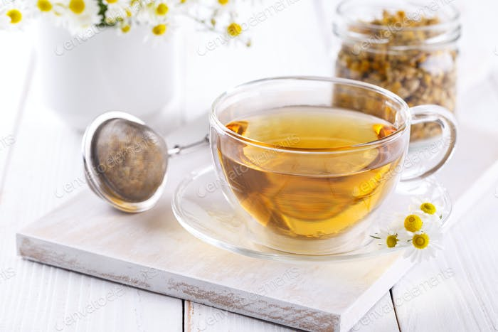 Healthy chamomile tea in a glass teacup