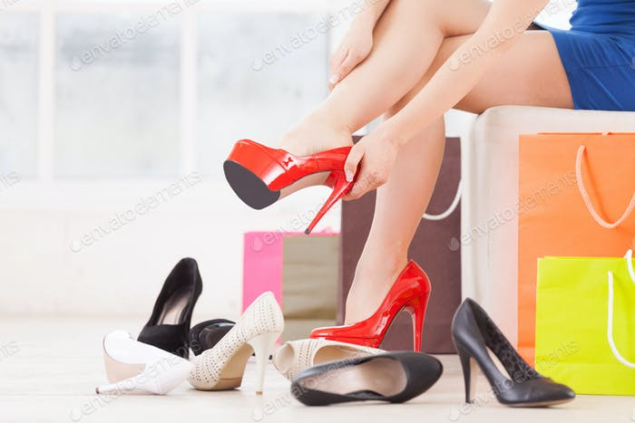 Woman at shoe store. Cropped image of young woman choosing shoes in a shoe store