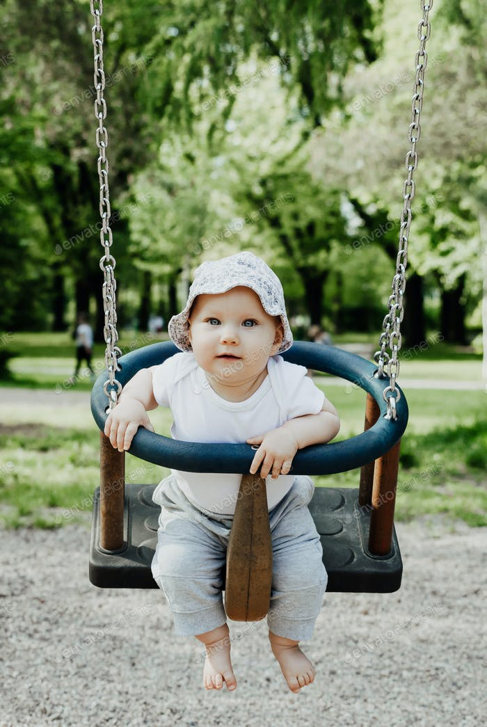 small child is having fun on a swing