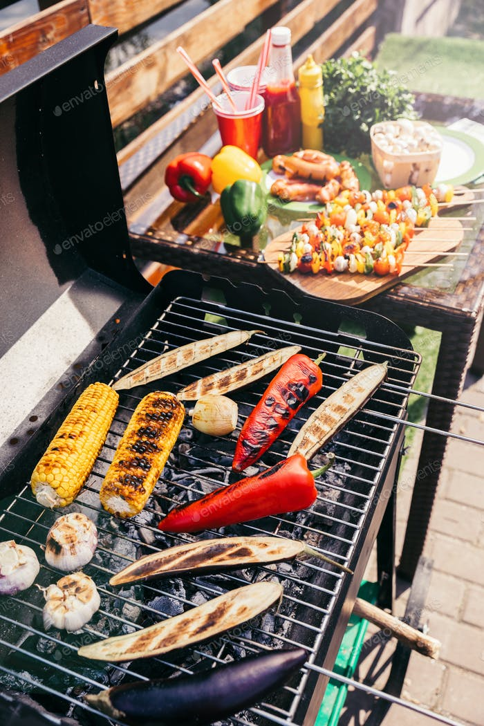 Fireplace with vegetables grilled for outdoors barbecue