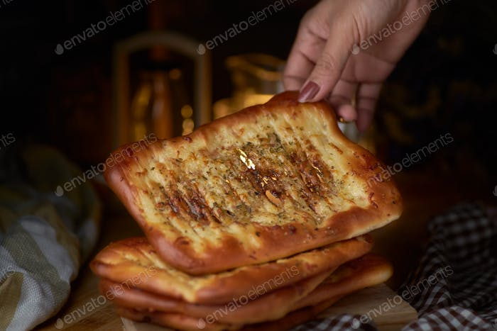 Stacking of spicy naan bread on table