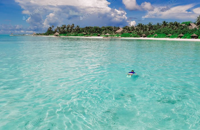Man swimming in the amazingly turquoise ocean