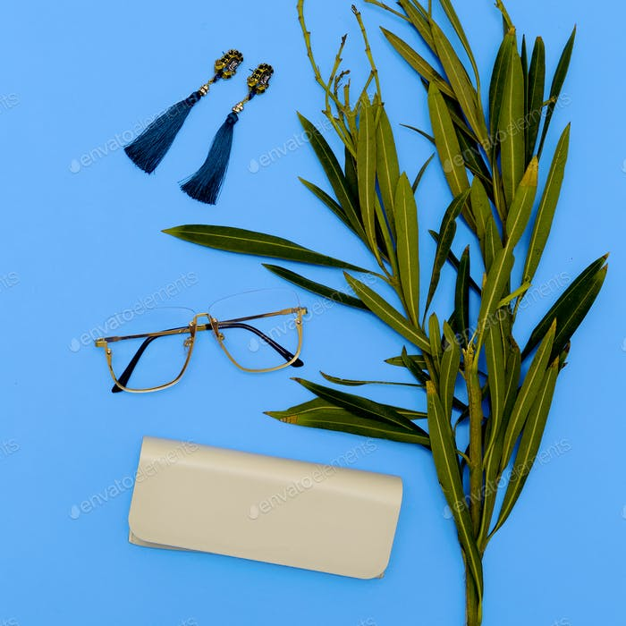 Glasses and Earrings. Stylish accessories for women. Flat lay mi