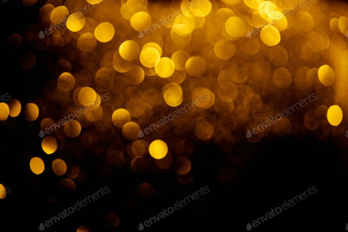 abstract decorative background with blurred golden glitter